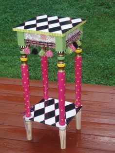 Harlequin painted table - oh,  the fluffy tassels......