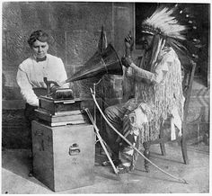 Frances Densmore of Red Wing, seen here with Mountain Chief (Sioux), conducted a personal campaign to capture Native American traditional music before it vanished from the continent. Setting out in the early 1900s, Densmore traveled to remote Indian villages where few other white women would dare venture. Her tools were a simple box camera and a cylinder phonograph. (Photo courtesy MN Historical Society) Native American Music, Native American Images, American Pride, Native American Indians, Native Americans, American Women, Radios, Phonograph, Dancing In The Rain