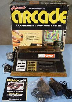 This is a really nice one, the Bally Astrocade. I love the brown 70:ish plastic and the controls looking like pistol handles. The cartridges look like tape cassettes. :)