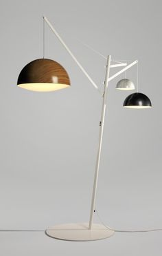 swiss designer adrien rovero has created 'mapping the light', a floor lamp that appears to reference the industrial world of construction cranes .