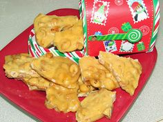 My husband's favorite Peanut Brittle is made in the microwave in just 7 minutes! I also make this as a quick and easy gift. Serve the Peanut Brittle on a football shaped cutting board with a hammer for cracking!
