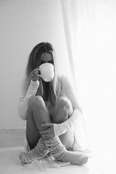 Coffee in the AM by a window in my cozy socks
