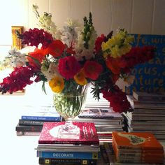 Spring flowers and colourful stacked books from Absolutely Beautiful Things.