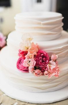 Simple white wedding cake with fresh flowers