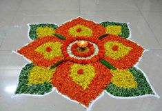 Diwali Special - Rangoli Design with marigold flowers, How to make rango. Diwali Special - Rangoli Design with marigold flowers, How to make rango. Rangoli Designs Simple Diwali, Diwali Special Rangoli Design, Rangoli Designs Flower, Small Rangoli Design, Rangoli Ideas, Diwali Rangoli, Rangoli Designs With Dots, Flower Rangoli, Rangoli With Dots