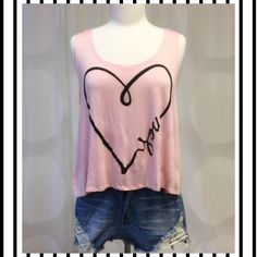 Just In Adorable trendy sleeveless heart top✨✨ Trendy new Retail top in Girly, soft pink and black heart topOnly 1 Medium available✨✨✨loose shorter fit. April Spirit Tops