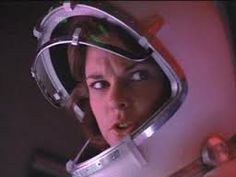 """Morse (Carolyn McCormick) pilots her space craft in the 1985 movie """"Enemy Mine"""""""
