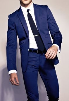 Groom will have a navy suit as well with white trim, navy shoes, white shirt, matching navy bow tie, coral handkerchief. Brides father navy suit, white shirt, gold tie, white handkerchief