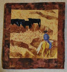 Checking Calves in Oklahoma.  Horse and rider piece was painted then appliqued and thread painted.  Background was raw-edge applique with thread painted grasses and detail on the horse and rider.