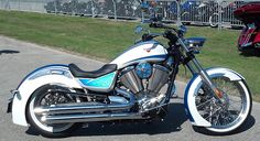 """Custom Victory Boardwalk. The Boardwalk replaced the Kingpin in Victory's lineup. Sadly, Victory decided to downsize another motorcycle; making the Boardwalk smaller and more inline with its H-D competition (Softail Deluxe) and further reducing the options for taller/bigger riders. In short: Seat height reduced 0.6"""", length reduced 2.7"""", wheelbase reduced 0.8"""",  ground clearance reduced 1.1"""", dry weight increases 9 pounds, and it loses the inverted forks. More like H-D is less for me to…"""