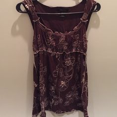 BCBGMaxAzria sleeveless top. Brown cute and flirty top. Perfect for spring and summer. Wear with a sassy pair of cropped jeans and a cool pair of sandals and you are set! BCBGMaxAzria Tops Tunics