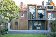 Completed in 2016 in Zeist, The Netherlands. Images by Ed van Rijswijk . A timber clad extension creates a new relationship between a brick semi-detached house and its green surrounding. Kraal Architecten and Lab-S have.