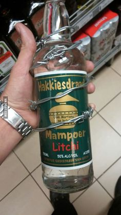 South African, Mampoer Litchi with barb wire around the bottle and a 50% alcohol volume! #packaging