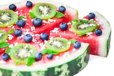 Watermelon pizza--watermelon, blueberries, kiwi, mint leaves, coconut shavings or cojita or feta cheese.