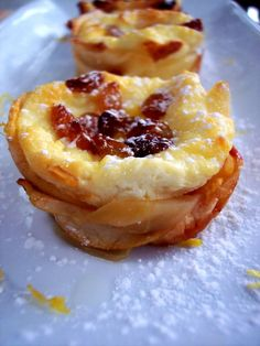 Apple Wrapped Ricotta Tarts - apple slices form crust. Rum soaked raisins, 4 firm apples, peeled & sliced thin, 8 oz ricotta cheese, 4 T sugar, 1 egg. Mix all but apples & drained raisins. Layer apple slices, spoon in ricotta, & top w/raisins. Bake 350F for 30-35 mins. until set and puffed. Cool then remove with spoon.