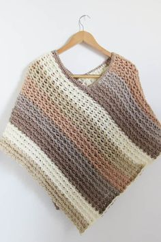 This free crochet poncho pattern for women comes in sizes small to plus sizes. Made from simple rectangle shapes, this poncho tutorial is quick and easy enough for beginners. Sie Poncho Tutorial Pattern for Crochet Poncho-Textured- Crochet Dreamz Crochet Shawls And Wraps, Crochet Scarves, Easy Crochet, Knit Crochet, Crochet Vests, Crochet Cape, Crochet Edgings, Crochet Shirt, Crochet Motif