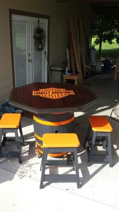 Harley Davidson barrel table and stools