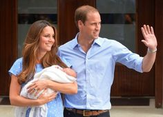 Kate, Duchess of Cambridge holding the infant Prince George, and Prince William, Duke of Cambridge.