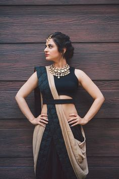 Simple and sophisticated. #cream #black #lehenga #statementnecklace