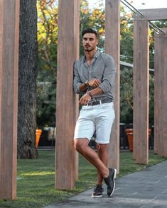 Summer casual outfit inspiration with white shorts black double monk shoes gray button up shirt button down collar with rolled up sleeves #summerstyle #summeroutfits #shorts #menswear #menstyle #mensfashion #doublemonks
