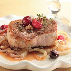 Slow cooker orange-cranberry pork.Pork tenderloin with cranberries cooked in crock pot.