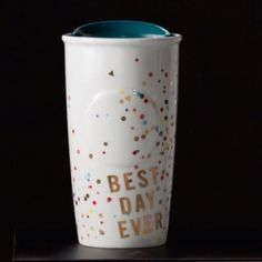 """Best Day Ever Confetti Double wall traveler Starbucks. Double-walled ceramic mug with a flutter of confetti and a good attitude. Adorned with a burst of real gold confetti, this mug and its message inspire you to find the good in each day. """"BEST DAY EVER"""" is printed below the mug's raised center dot. Double wall construction helps keep coffee hot while hands stay cool, and its blue ceramic press-in lid with silicone seal minimizes spills. 12oz. Handwash. X microwave. No trade or pp.   LAST…"""