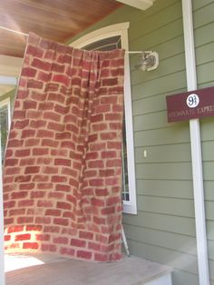 I made the platform 9 and 3/4 for our Harry Potter party.  It was pretty simple to do.  Sheet from Goodwill, sponge, and red and brown craft paint was all that was needed.  I squirted together but did NOT mix the paints on a plate to give the more authentic brick look.  It was a hit!