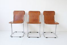 3 BROWN LEATHER CHAIRS http://www.galerie44.com/fr/collection/assises/3-brown-leather-chairs-detail