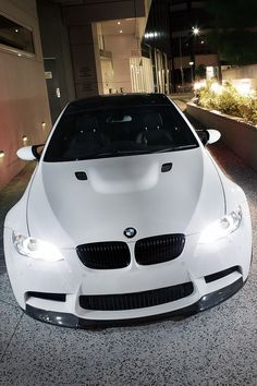 BMW in white with black splitter.