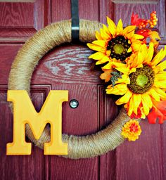 Monorgrammed Twine Wreath with Sun Flowers and Fall Foliage.