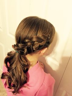 Dutch braid into ponytail with curls on ends