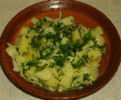 Photo of Greek potato salad with olive oil and lemon dressing - Photo © Jim Stanfield