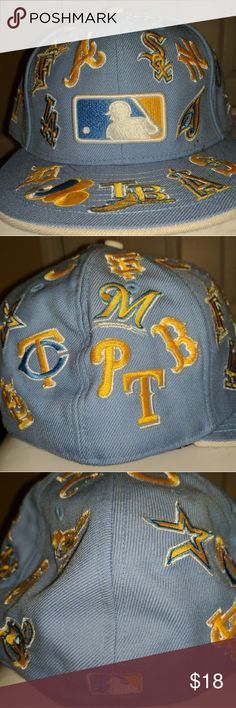 New Era MLB Logos Fitted 59FIFTY fitted with MLB logos. baby blue hat with yellow and white embroidery. New Era Accessories Hats