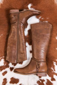 Looking for a stylishly simple flat boot to serve as a basic in your fall wardrobe? The Lariat Tall Riding Boot from Matisse feature a Western inspired braided strap and burnished leather. - Leather u