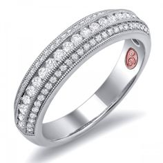 DemarcoJewelry.com  Available in White or Yellow Gold 18KT and Platinum. 0.38 RDCapture her grace and endless beauty with this confident yet elegant design. We have also incorporated a unique pink diamond with every single one of our rings, symbolizing that hidden, unspoken emotion and feeling one carries in their heart about their significant other. This is not just another ring, this is a heirloom piece of jewelry.   Demarco Bridal Engagement Ring.
