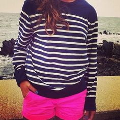 Neon pink shorts with navy striped top