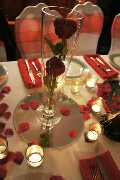 Conical Vase,Red Roses, mirror plate, tea lights and scatter rose petals. Wedding centrepiece, Ruby anniversary, Red wedding theme www.weddingandparties.co.uk