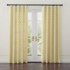 Gold-on-white lattice motif creates a bold yet classic design, printed on 100% lined cotton curtain panels.