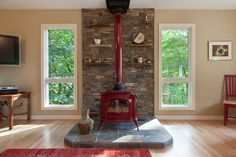 Narrow Stove for Traditional Spaces Also Cabin Contemporary Country Joel Fraley Living Room Natural Stone Neil Kelly Red Red Fireplace Red Wood Burning Stove Shelves Slate Stone Wall Wood Floors Wood Stove Eclectic Living Room, Living Room Modern, Interior Design Living Room, Room Interior, Interior Ideas, Wood Stove Wall, Diy Design, Pellet Stove, Room Corner