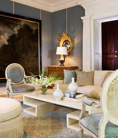 Neoclassical Design Style Furniture Interpretation: Blue Fauteuil Chairs. A damask custom rug pulls together blue, brown and gold Neoclassical and modern furniture in the living room of a Virginia estate. Design by Thomas Pheasant.