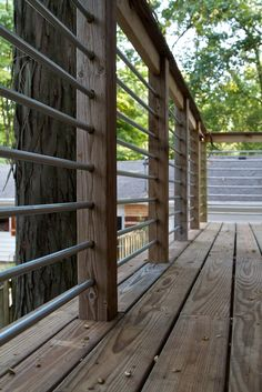 Metal railing for elevated deck. Made of conduit.
