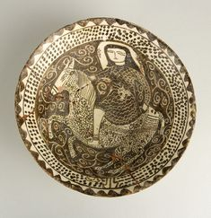 "Kashan Style Bowl - ADC.83 Origin: Central Asia Circa: 1100 AD to 1200 AD Dimensions: 4.21"" (10.7cm) high x 9.45"" (24.0cm) wide Collecti..."