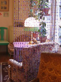 Bead curtain - we had a beaded divider in our first rented home, only they were gold and black.  Fun memories!  Oh, and that was the year 1971.