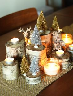 Recreate a shimmery forest with miniature evergreens and carefully carved logs.  See more at The Sweet Escape »    - HouseBeautiful.com