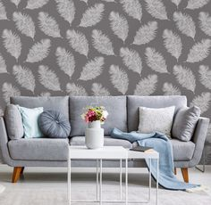 Hawthorn is a beautiful design featuring a floating chalky feather wallpaper design that contrasts against a grey matte background. Feather Wallpaper, Grey Wallpaper, Nature Wallpaper, Door Murals, Nature Tree, Designer Wallpaper, Vivid Colors, Love Seat, Living Spaces