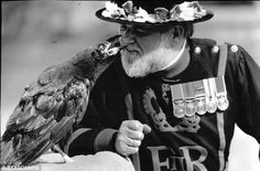 Close bond: A Raven Master meets a young bird at the Tower in the 1980s