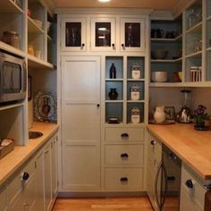 Walk In Pantry: built in fridge for platters and cake decorating. perhaps a deep freezer too!