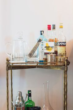 A classic take on the bar cart. Look around your local flea market for some interesting glassware in different sizes. A variety of different glasses in different shapes and sizes, but within a similar color scheme makes for an easy way to tell which glass is whose.