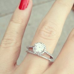 Round diamond with halo ring, narrow shank, and matching skinny band.
