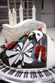 Phantom of the Opera cake!!! I would LOVE this at some kind of function of mine. i dont care if it doesn't go with the theme lol